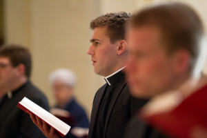 Young seminarian with hymnal